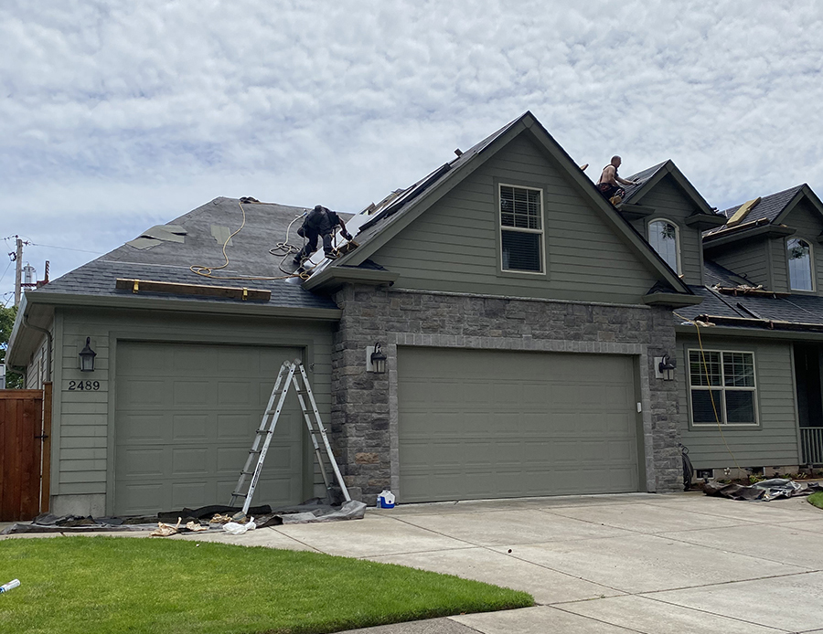 Two People Working On A Roof2